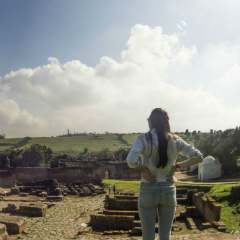 Student looks at pre-modern ruins in Morocco