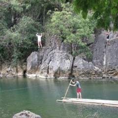Students on raft and rope bridge in Philippines