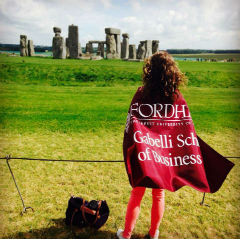 Student with Gabelli flag by stonehenge