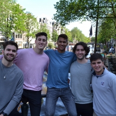 Five students stand in Amsterdam