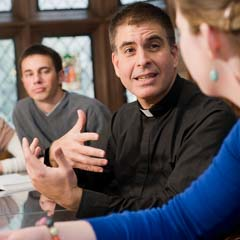 Priest Engaging with Students - SM