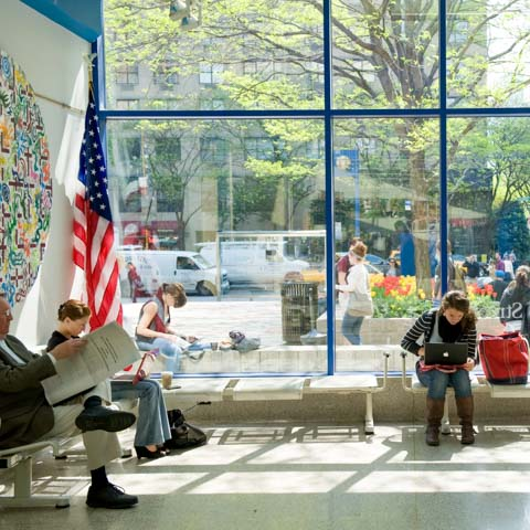 Students in Sunlit Lobby
