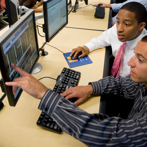 Two Students Checking PC Screen