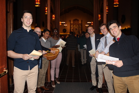 Students welcoming people to the University Church