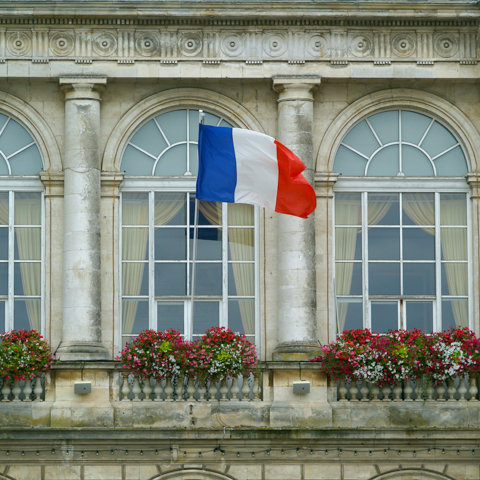 French flag in front of building - LG