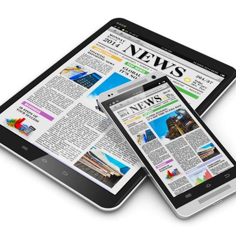 iphone and iPad with newsprint - LG