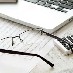 Laptop, Eyeglasses, and Spreadsheets - SM