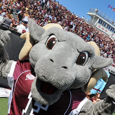 The Fordham Ram mascot cheers on the team.
