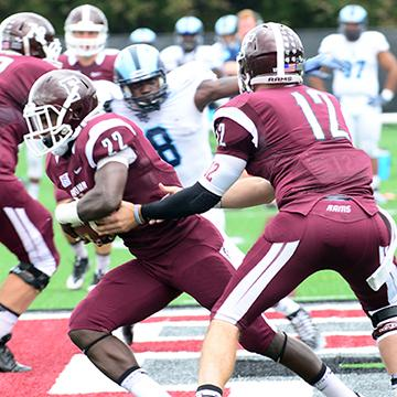 Fordham Football team passes ball during homecoming game.